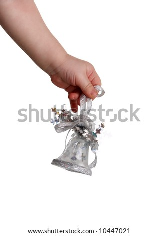 The children's hand holds handbells - stock photo