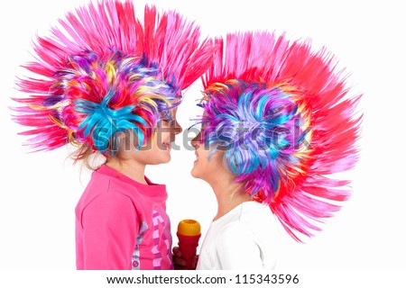 The children sing with colorful wigs - stock photo