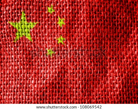 The Chinese flag painted on fabric surface - stock photo