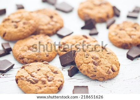 the chocolate cookies on old wooden table - stock photo
