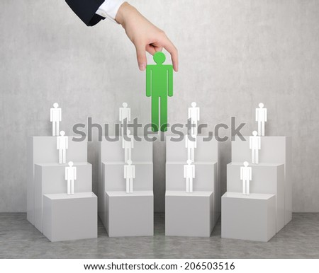 The choice of the best suited employee. Green human as a symbol of chosen one by the recruiter. HR, HRM, HRD ,CRM concepts. - stock photo