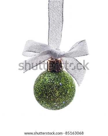 The christmas decoration - green ball and silver ribbon - stock photo
