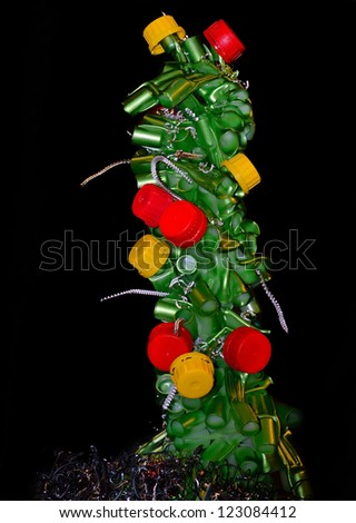 The Christmas fir-tree is made of industrial wastes and marriage. - stock photo