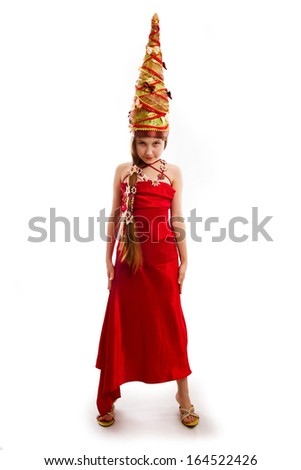The Christmas girl in a carnival red dress - stock photo