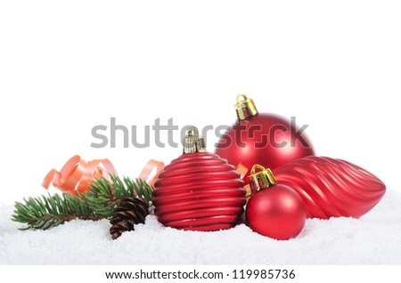The christmas tree ball in snow isolated