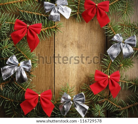 The Christmas Wreath on the wooden background