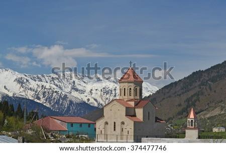 The Church in the mountainous Mestia, Georgia - stock photo