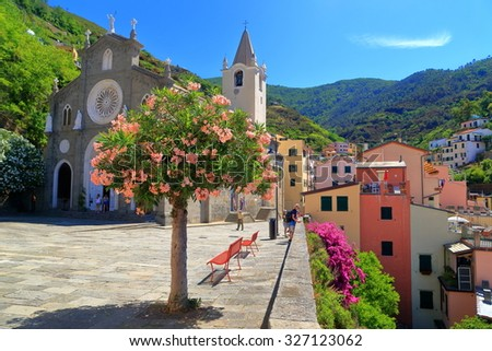 The church of San Giovanni Battista in sunny square, Riomaggiore, Cinque Terre, Italy - stock photo