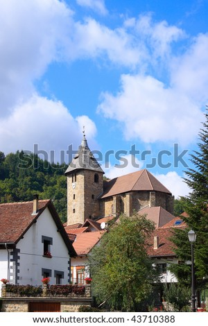 The church of San Juan Evangelista in Ochagavia, a little village in the north spanish mountains. Sunny day. - stock photo