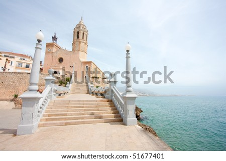 The church of Sant Bertomeu and Santa Tecla is the one of the most popular landmarks of Sitges. It unmistakably identifies Sitges' skyline. - stock photo