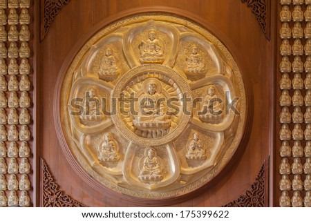 The circle of golden buddha wood