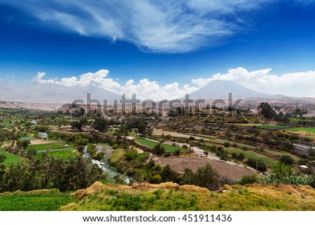 the city and the field at the sleeping volcano - stock photo
