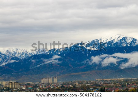 The city at the foot of the mountains, overcast