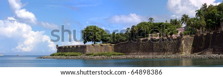The city boundary and old decaying wall of El Morro fort located in Old San Juan Puerto Rico. - stock photo