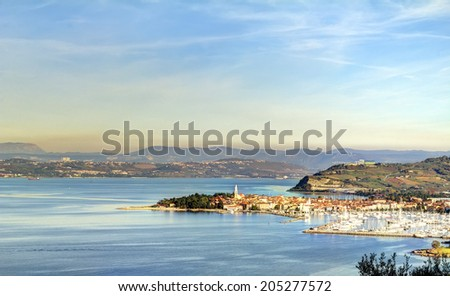The city called Isola is located in Slovenia, Europe. The picture shows the sea line and coast view of the old city part that was built on the foundations of the Roman Empire.