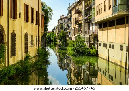 The city canal San Massimo runs among residential houses in the centre of the old city Padua, Veneto, Italy - stock photo