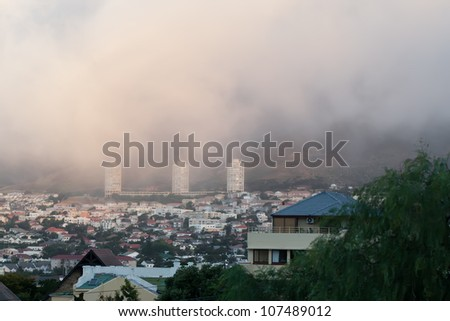 The city of Cape Town is laying under a huge layer of smoke. - stock photo