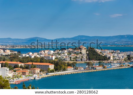 The city of Chalkida, Evia, Greece against a blue sky.  Chalkida is located on Evia island and is connected to mainland Greece via two bridges. - stock photo