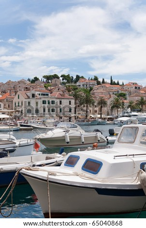 the city of hvar and its harbor in the adriatic sea - stock photo