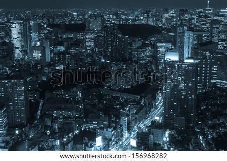 The cityscape of Tokyo at night in cold blue tones. - stock photo