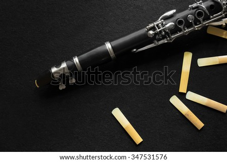 The clarinet on black background - stock photo