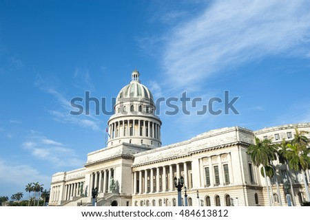 The classic architecture of the Capitolio building stands under bright Caribbean blue sky in Central Havana