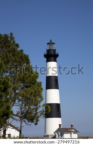 The classic Bodie Island lighthouse is a popular destination in the Outer Banks - stock photo