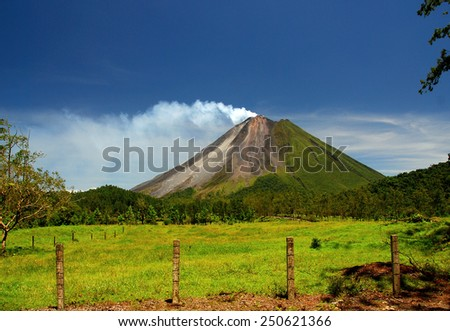The Classic Cone Shape of Arenal Volcano in Costa Rica. - stock photo