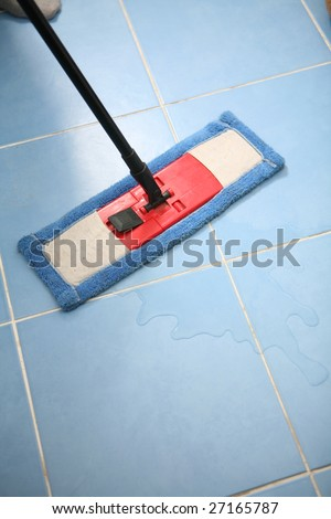 The cleaner washes a floor. - stock photo