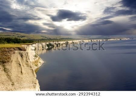 the cliff by the sea in cloudy weather - stock photo