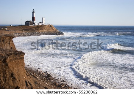 The cliffs, Montauk Point Lighthouse and the turbulent Atlantic Ocean.. Located in Montauk Point, Long Island, New York. - stock photo