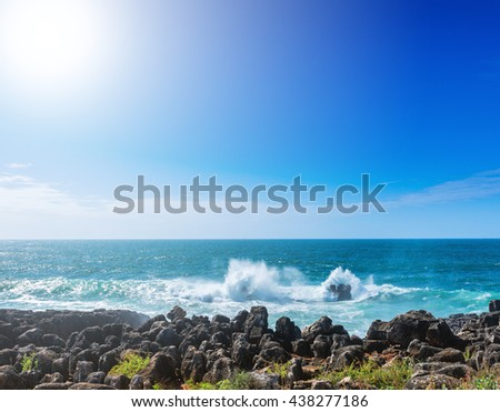 The cliffs on the coast of the Atlantic Ocean. Ocean waves, Cascais, Portugal. Beauty in nature. Beautiful marine landscape in backlit. - stock photo