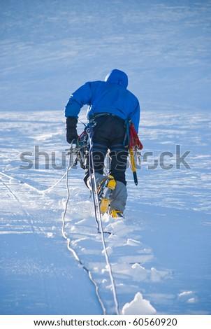 the climb on snowy peak - stock photo