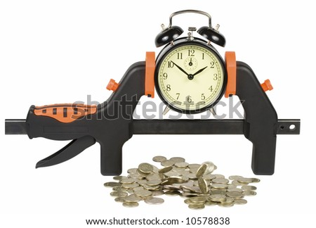 The clock clamped in a manual clamp and falling coins, isolated on a white background. Clipping path included.