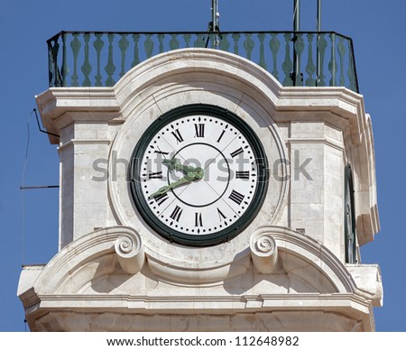 The clock on the tower Patio das Escolas of the Coimbra University in Portugal - stock photo