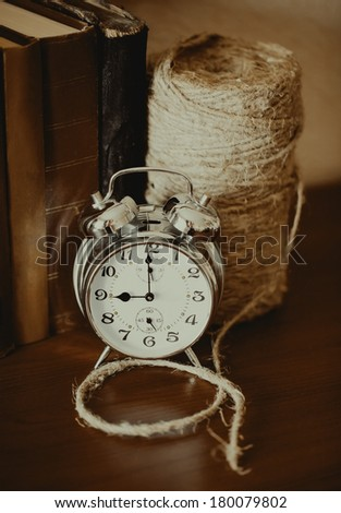 The clock on the wooden table - stock photo