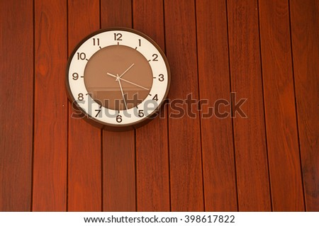 the clock on the wooden wall