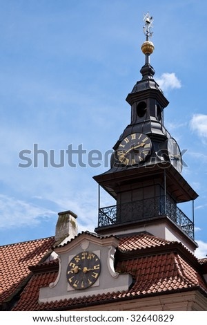 The clock with Hebrew and Roman faces on the old Jewish Town hall in the Josefov, or Jewish Quarter, Prague, Czech Republic - stock photo