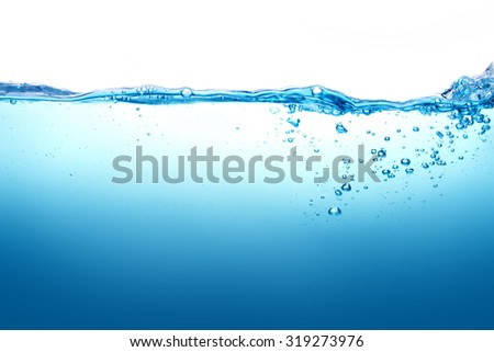 the Close up blue Water splash with bubbles on white background - stock photo