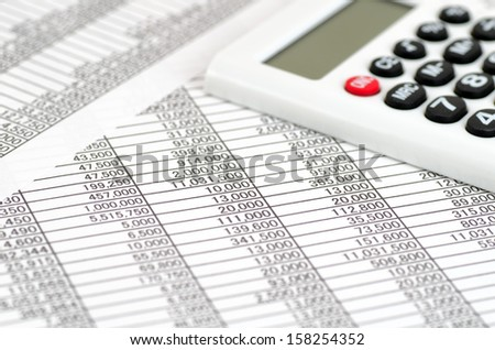 The close-up of a the calculator and Accounting documents.