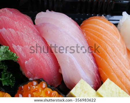 The close up of Japanese delicious sushi in the lunch box set. - stock photo