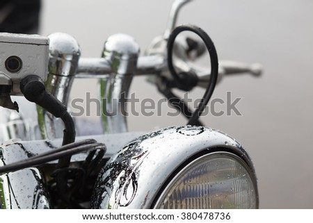 The close up of motorcycle wheel with headlight - stock photo