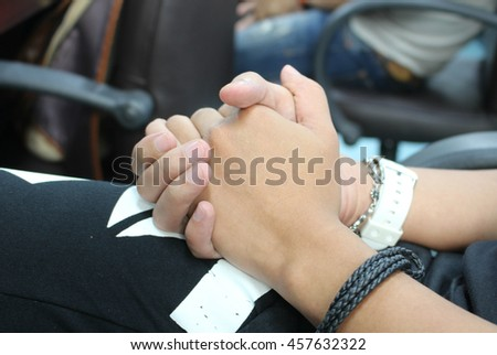 The close up shot of couple hand holding together concept of secret love, care, encourage and relationship - stock photo