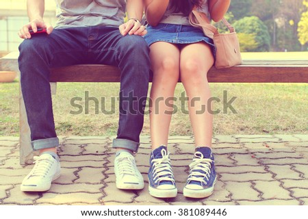 The close up shot of hipster couple sitting together, shoes of hipsters resting concept of love, relationship, relaxing family and hipster  - stock photo