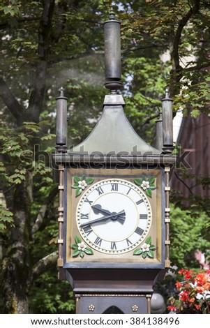 The close view of an original steam clock in the historic district of Vancouver city (British Columbia, Canada) - stock photo