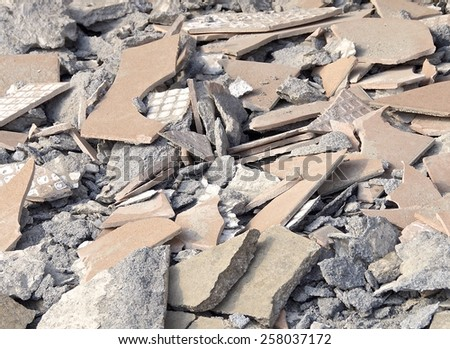 The close view of debris at destroyed construction site - stock photo