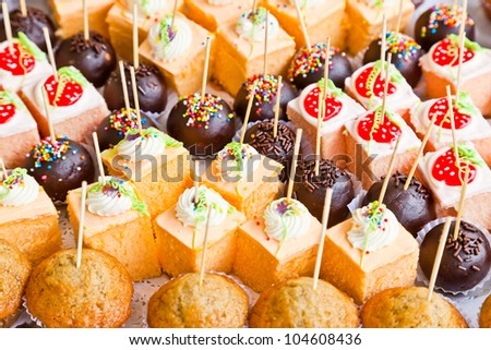 The closeup image of the various small cup cakes - stock photo