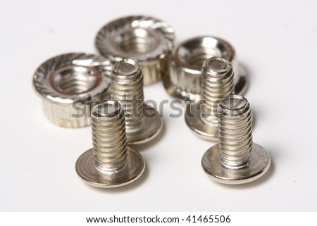 The closeup of many screws and nuts