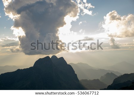 the cloud conceal the sun above the mountain