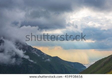 the clouds on the mountain tops